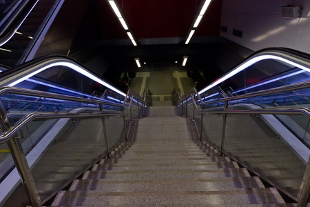 Stairway and eksalator blue light, stairway - Metro a station Barcelona