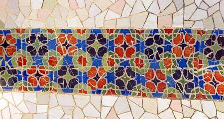 gaudi:  tile mosaic wall in park city Barcelona designed by Antoni Gaudi Editorial