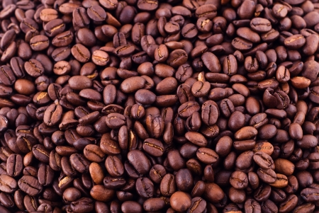 Coffee close-up brown beans texture background photo