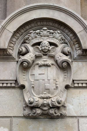 detailed old architecture facade heraldry of Barcelona, Spain