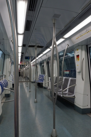 Interior of a passenger metro train with empty seats