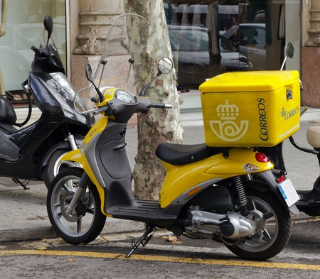 SPAIN -  For post distribution spanist correos use mainly yellow motos instead, Spain