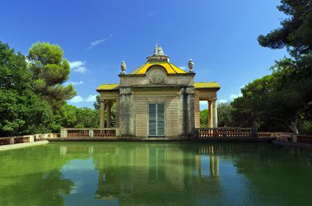 Summer old pavilion of pond water. Parc del Laberint. Barcelona. Spain  photo
