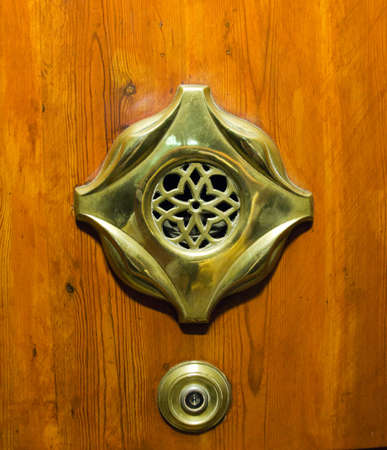 peephole: old peephole view at wooden door  Stock Photo