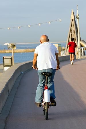Old man riding a mountain bike outdoor photo