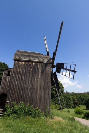 Wooden old windmills near the village in Folk Arts museum Pirogovo, Kiev, Ukraine photo