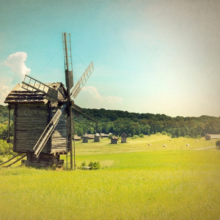 old windmill near a village - retro style  photo