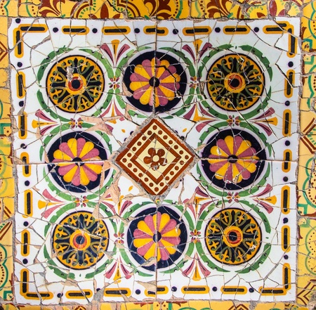 tile mosaic wall in park city Barcelona designed by Antoni Gaudi. Spain. photo