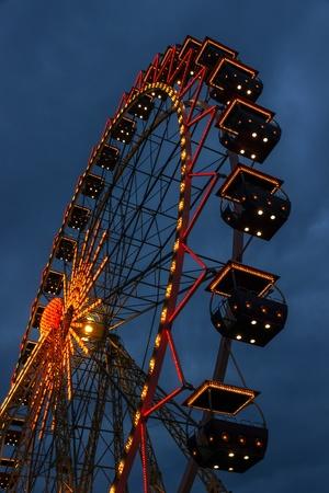 carrousel: ferris wheel carnival illuminated at night