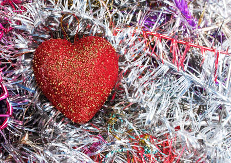 Red heart and festive curly ribbons xmas background photo