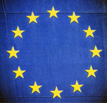 Vintage European Union stars glare on dark blue grunge textures  photo