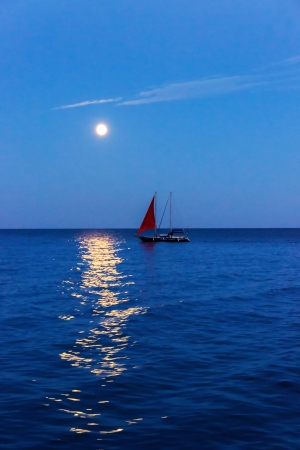 boat scarlet sail and moon on blue ocean wave