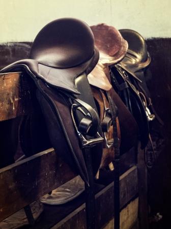horse show: vintage leather saddle horse close up detail