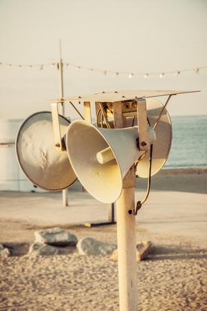 megaphone in Beach Barcelona. Catalonia, Spain. Vintage retro style photo