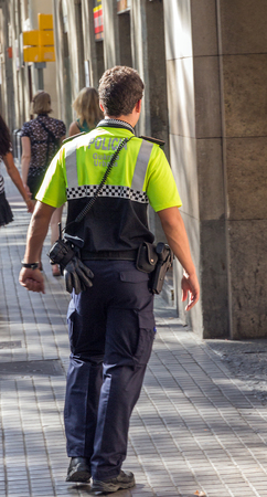 Spain police officer on duty Barcelona. photo