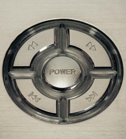 silver metal power button macro closeup