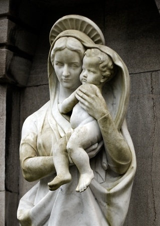 Statue of Virgin Marie carrying the child Jesus Stock Photo