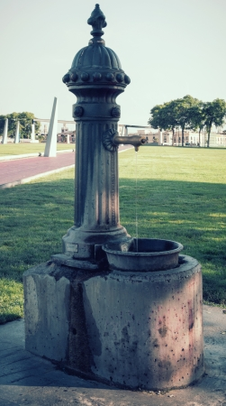 water to drink in tap Barcelona. Catalonia, Spain. Vintage retro style photo