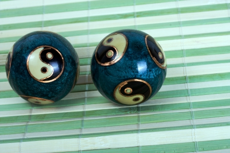 two chinese balls for relaxation on bamboo background photo