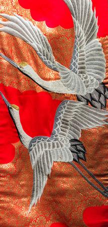 Vintage Japanese background crane on silk kimono woman photo