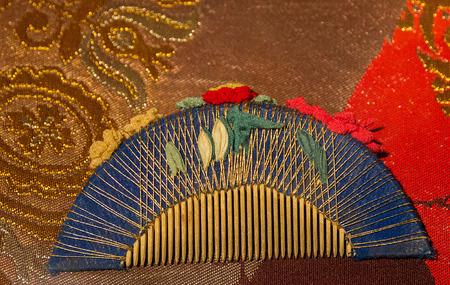 comb in Japanese silk kimono woman photo