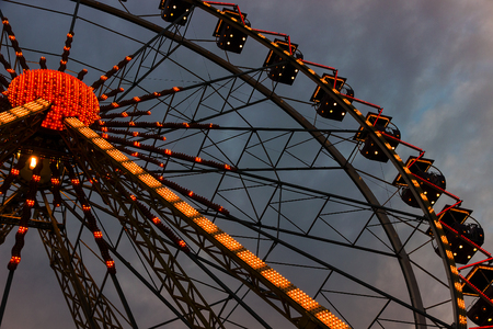 ferris wheel carnival illuminated at night in city park photo