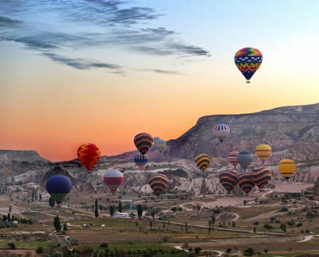 The morning hot air balloons fly over Cappadocia National Park. Urgup, Goreme, Guzelyurt and Uchisar. Turkey.