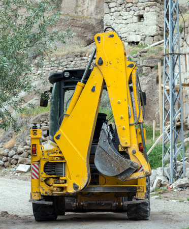 dirtied: The bulldozer yellow excavator at construction Site Stock Photo