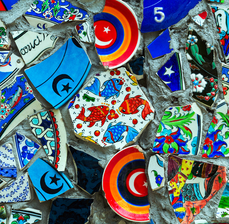 sign Turkey and fish in mosaic of broken ceramics wall in Istanbul photo
