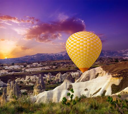 aeronautical: yellow hot air balloon flying sunrise rock