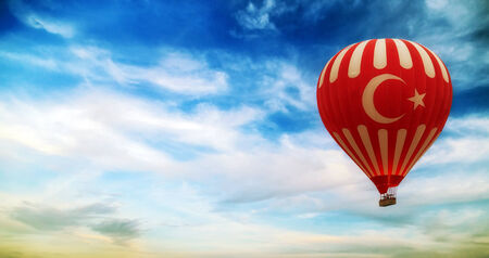 turkey flag hot air balloon flying blue sky with clouds photo