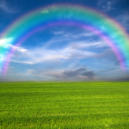 emptiness: green field rainbow blue sky nature background