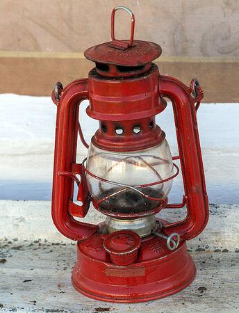 Vintage lamp red lantern, rusty kerosene lamp photo