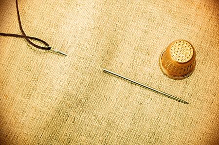 needle thread thimble vintage retro style Stock Photo