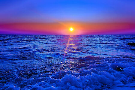 beautiful sunset on by sea background natural photo
