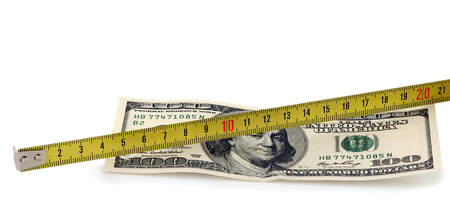 US currency and tape measure isolated photo
