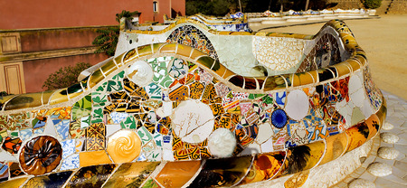 colorful ceramic bench at Parc Guell designed by Antoni Gaudi, Barcelona, Spain. photo