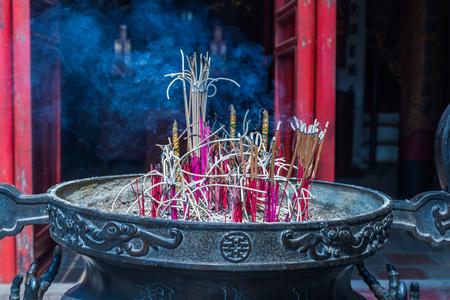 spiraling: burner incense sticks in a buddhist temple Stock Photo