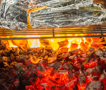 salmo trutta: Grilled Seafoods - BBQ Charcoal Grill With Flames Of Fire. Stock Photo