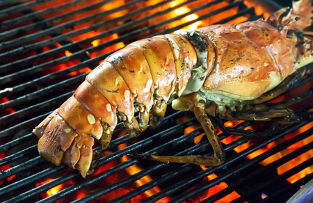 raw lobster: Barbecue Grill cooking seafood. background eat Restaurant Stock Photo