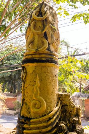 phallus: Gold phallus sculpture of penis on Koh Samui island, Thailand
