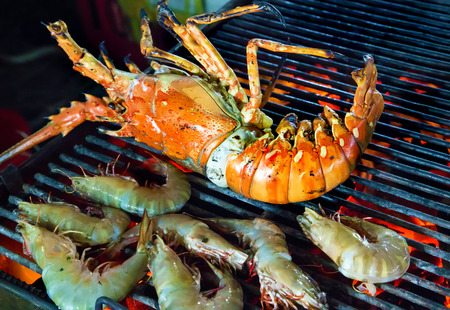 shrimp and lobster dinner at the restaurant seafood by fire and BBQ Flames. photo
