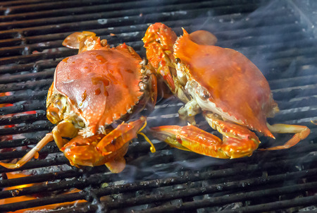 crab: seafood crab by fire and BBQ Flames. Restaurant Barbecue at the night market