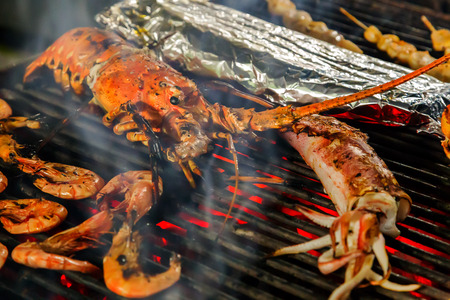 prepared shellfish: Prepared Shellfish, seafood, shrimp by fire and BBQ Flames. Restaurant Barbecue at the night market