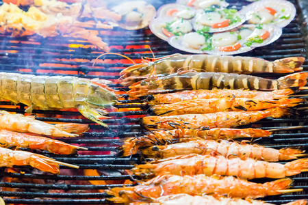lobster dinner: lobster dinner at the restaurant seafood shrimps by fire and BBQ Flames. Stock Photo