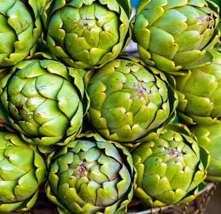 artichokes for sale at a farmers' market