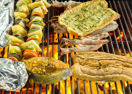 long loaf: Barbecue Grill cooking seafood and long loaf, bread. background eat Restaurant Stock Photo