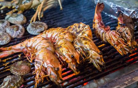 prepared shrimp: prepared shrimp, prawn grilled barbecued mixed seafood in BBQ Flames.