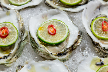 seafood: scallop shell on ice exposition sea market. Seafood on ice Stock Photo
