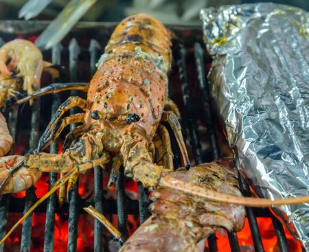 lobster tail: Lobster grilled barbecued seafood in BBQ Flames.